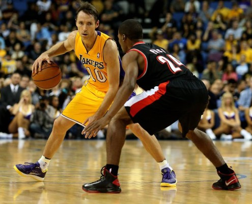 Steve Nash handles the ball sizing up the Portland defender.